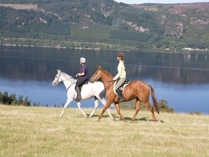Enjoying the views of Loch Ness on horseback
